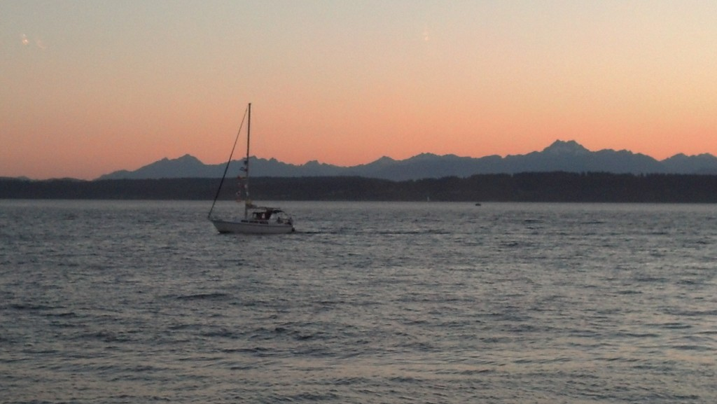 One of the quintessential shots, Ray's Boathouse. Olympic Mountains in the distance, a lone sailboat en route to the Locks.