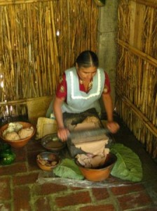 The mother of the Navarros family who worked this metate for hours creating the paste for the tejate we were served later